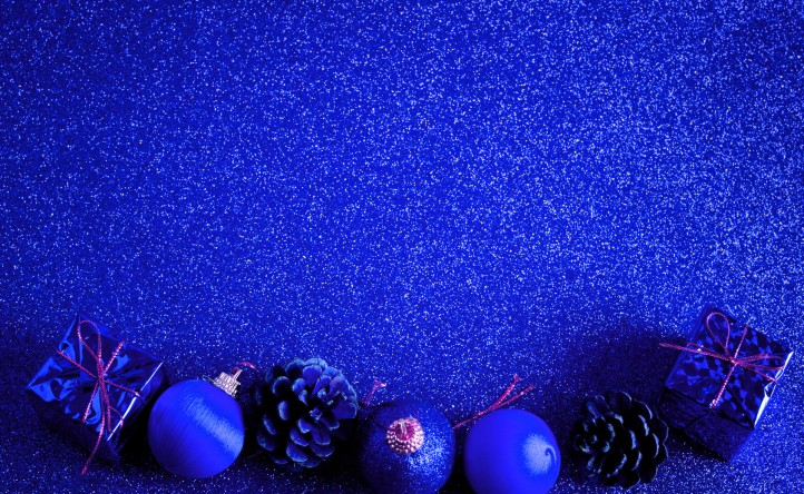 blue christmas ball and gift decoration on the glitter background